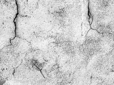 鉄筋コンクリートがひび割れた様子の画像